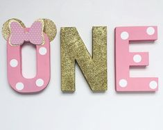 Decorative Minnie Mouse theme first birthday party freestanding letters for baby girl birthday party. Standing letters for treat table or girl cake smash props. Perfect for photo shoot prop or party decoration! Minnie Mouse Birthday Outfit, Minnie Mouse Theme, Baby Girl 1st Birthday, Boy Birthday Parties, Birthday Ideas, Mouse Outfit, Minnie Mouse Party Decorations, Birthday Party Decorations, Disneyland