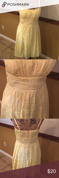 Pale yellow spaghetti strap dress Dress is knee length. Size 10. Has circle pattern on dress. Dress is like a pale yellow. Has a flare out bottom. Straps are adjustable. Has been worn twice, in good condition. jcpenney Dresses Midi