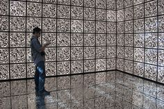 'i-city,' in the upstairs level, consists of three rooms with a grid of QR codes wrapping the walls, floors and ceilings. shelves of tablet PC's greet visitors which convert them into scientists and explorers, left free to roam the halls using their tool to take pictures of the codes and discover information about the skolkovo project, a new city which promotes architectural and technological innovations   in russian urbanism.