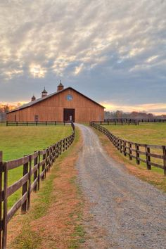 Barn with a long drive way and pastures