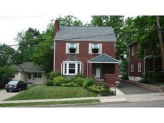 Classic 1940s Brick 3 Bdrm, 1 1/2 Bath 2 story w/striking features both new & old;  Brand new Kit w/high end appls;  Din Rm; 1st fl Den/office ; Wd burning frplc in lg Liv Rm; Replacement windows; LR Bay window w/copper roof; sitting porch; Fantastic front & rear entrance foyers; new front walkway & landscaping; Truly move-in!!!   BOM because of Buyers financing!!!