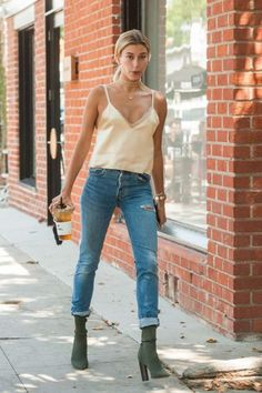 Hailey Baldwin wearing Shay Ripple Choker, Shay Essential Pave Baguette Diamond Necklace, Yeezy Season 2 Boots and Are You I Am Zillah Camisole in Gold