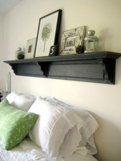 A shelf above the bed with art and other accessories is a great way to fill that awkward space - Happy at Home