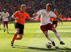 Daniel Agger Dirk Kuyt of the Netherlands and Daniel Agger of Denmark tussle for the ball during the 2010 FIFA World Cup Group E match betwe...
