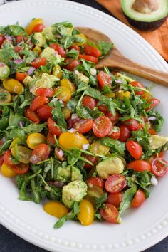 Juicy cherry tomatoes, spicy arugula, and creamy avocado tossed with a tangy balsamic vinaigrette is the most flavorful healthy tomato salad side dish! Vegan, dairy-free, gluten-free, soy-free, nut-free.
