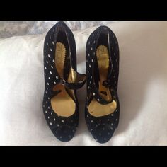 Black velvet heels. These are very feminine, chic, and have a really cute retro look to them.  Worn a couple of times but they are in excellent condition. Zinc Shoes Heels