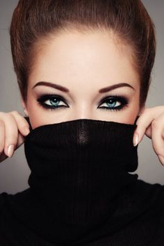 Fashion brunette woman with magnetic green eyes