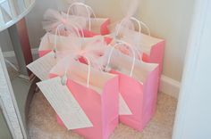 shower game : spin on the traditional toilet paper wedding dress game. Instead of toilet paper however, the groups each received a bag with various supplies so that they could fashion their own more realistic wedding dress. Each bag contained satin, tulle, various types of white ribbon, silk flowers, bobby pins, safety pins and scissors.