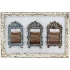 """Add a chic touch to your living room or foyer with this lovely wall decor, showcasing 3 Baroque-inspired picture frames with a distressed finish.     Product: Picture frame     Construction Material: Wood   Color: Distressed ivory frame     Features:   Holds (3) 3.5"""" x 5"""" photos   Scrollwork details         Dimensions: 13.5"""" H x 20.5"""" W x 1"""" D"""