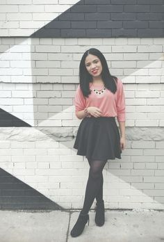 Shop this look on Lookastic:  http://lookastic.com/women/looks/long-sleeve-t-shirt-skater-skirt-necklace-ankle-boots-tights/9466  — Pink Long Sleeve T-shirt  — Black Skater Skirt  — Gold Necklace  — Black Cutout Suede Ankle Boots  — Black Tights