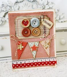 I love her layers of fabric, washi tape, twine, cardstock, buttons. It all works so well together. Need to try working more with fabric.  Thanksbuttons2-Melissa Phillips