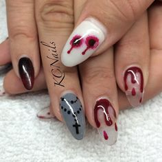 pretty_in_polish92's photo on Instagram - fun Halloween NailArt - Love the bite marks!