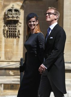 Actress Sarah Rafferty and her husband Santtu Seppala arrive for the wedding ceremony of Prince Harry and Meghan Markle at St. George's Chapel in Windsor Castle in Windsor, near London, England, Saturday, May 19, 2018. (AP Photo/Alastair Grant, pool)