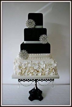Sophisticated black, white and silver buttercream wedding cake with ruffles. Enjoy RUSHWORLD boards, WEDDING GOWN HOUND, WEDDING CAKES WE DO and UNPREDICTABLE WOMEN HAUTE COUTURE. Follow RUSHWORLD! We're on the hunt for everything you'll love!