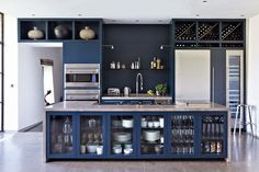 Decorating with dark paint doesn't mean you'll end up with a room of Stygian gloom. In fact the very opposite. Used properly drama and atmosphere await. Like this dark blue kitchen.