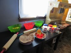 """APPLE PIE KITCHEN- using this activity to go along with the book theme this week: """"10 Apples Up On Top."""" Felt and pom poms along with spices, rolling pin and pie tins..."""