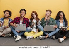 Multiethnic group of happy young friends with laptops sitting and smiling over yellow background Photo Logo, Group Photos, Yellow Background, Laptops, Friends, Happy, Movies, Movie Posters, Image