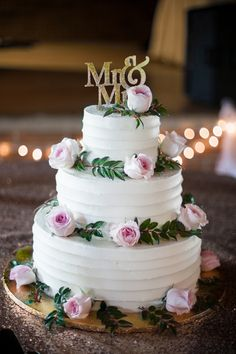 Simple white wedding cake with pink roses  ~  we ❤ this! moncheribridals.com #whiteweddingcake