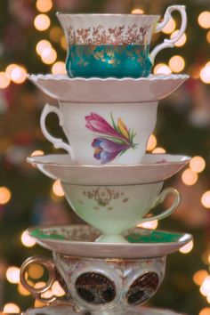 vintage teacups stacked for centerpiece, then for coffee with the cake? Cute