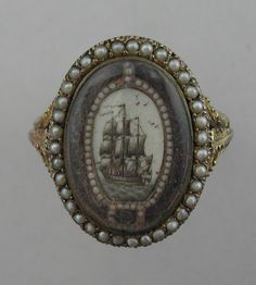 Mourning ring memorializing Elizabeth (Armstrong) Turnour, 1st Countess Winterton, died 1 Dec, 1841. Ring c. 1778, possibly wedding or sentimental token, altered c. 1841.  Ship symbolizes departure of the soul; pearls, tears; buckle, undying love.  Inscribed on bezel and shank.