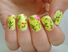 Lovely yellow nails with floral and bird art