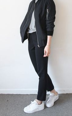 Minimal trends   Black bomber jacket, grey shirt, black pants, white sneakers