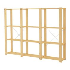 GORM 3 sections/étagères IKEA, or something similar (this one is €50 eek, and doesn't seem to come in one section).  Replace part of shelving with table to have shelf space above desk.  Or go for something 1/2 height and butt it up to back of couch (need to protect couch, in that case)