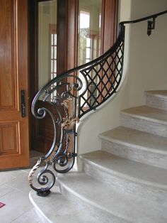 Fabulous Scroll Wrought Iron Half Railing: Flowing curves that follow the architecture of the staircase.