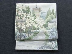 This is a Fukuro obi with 'Sakura'(cherry blossom) and shrine design, which is woven