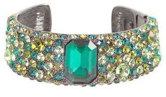 Kenneth Jay Lane green hermitage pave cuff bracelet. Via Diamonds in the Library.