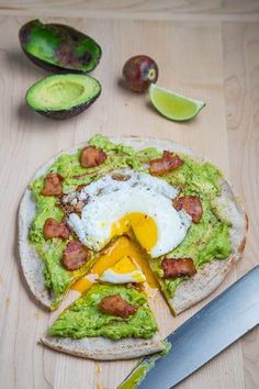 Made w/ buckwheat wrap - Avocado Breakfast Pizza with Fried Egg1/2 cup avocado, mashed 1/2 lime, juice salt and pepper to taste 1 pita, lightly toasted 1 egg, fried 1 strip bacon, cut into 1 inch sliced, fried and draind (optional) 1 tablespoon queso fresco, crumbled (optional) Directions Mix the avocado, lime juice, salt and pepper, spread it on the toasted pita and top with fried egg and other toppings.