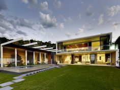 This two storey Australian home has a landscaped backyard with swimming pool, patio and pergola.