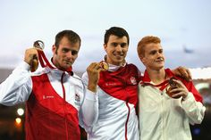 (L-R) Silver medallist Luke Cutts of England, gold medallist Steven Lewis of England and bronze medallist Shawnacy Barber of Canada