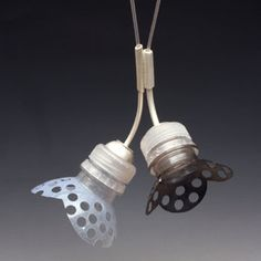 Liaung-Chung Yen: Necklace in sterling silver and plastic. Interchangeable tops and base