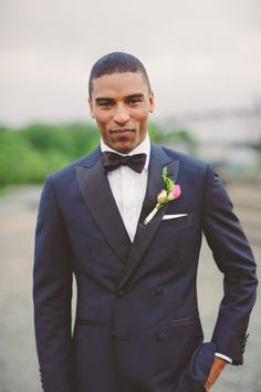 My man will be wearing a navy tuxedo for our wedding!