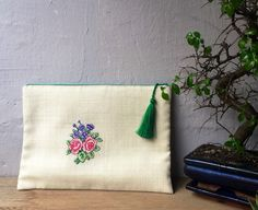 A personal favorite from my Etsy shop https://www.etsy.com/listing/591177456/boho-cross-stitch-hand-bag-roses
