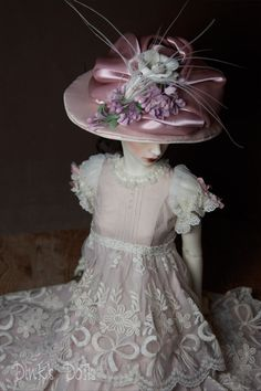 """Victorian Rose"" This hat is Edwardian in style and captures all the glamor of the era. Try it straight on the head or tilted slightly to the side. Pink satin cream with a deeper rose colored crown. Hand draped and violet feather adornment with white cut peacock feather....scrumptious!!!!! Size 8/9  Price: $75.00 - SDink (flickr)"
