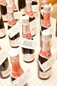 "Attach escort cards directly to your chosen favors. These champagne minis make a wonderful ""thank you"" or can be popped during your wedding toast. Photo Credit: Melissa Tuck on Glamour"