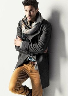 Something as simple as teaming a dark grey overcoat with camel casual pants can potentially set you apart from the crowd.   Shop this look on Lookastic: https://lookastic.com/men/looks/overcoat-long-sleeve-shirt-chinos/5138   — Grey Plaid Scarf  — Charcoal Overcoat  — Teal Plaid Long Sleeve Shirt  — Brown Leather Belt  — Khaki Chinos