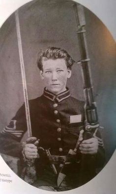 "Lt. Charles Powell, Co. B (""Black River Tigers""), 10th North Carolina Battalion Heavy Artillery with a Colt revolving rifle."