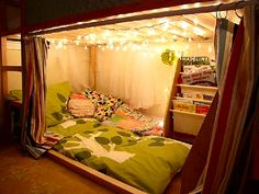 Kids Reading Nook – Turn the lower section of a basic bunk bed (think IKEA), some Christmas (fairy) lights and a curtain into a cozy, intimate reading fort for your child!