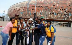 Fans and Helman Mkhalele during the Absa Premiership match between Orlando Pirates and Kaizer Chiefs at FNB Stadium on December 2014 in Johannesburg, South Africa. Image by: Lefty Shivambu/Gallo Images Kaizer Chiefs, Supersport, Orlando, Pirates, South Africa, December, Soccer, Fans, Image