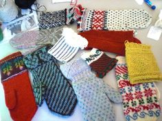 Collection of mittens knit in traditional Scandinavian patterns from the Nordic Knitting Conference in Seattle, WA.  From the collection of the instructor.