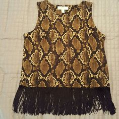 Michael Kors Top.                        NWOT Michael Kors Top.  95% polyester,  5% elastane. Never worn. All fringe is intact. Super cute! 26 inches from shoulder seam to bottom of fringe. Michael Kors Tops