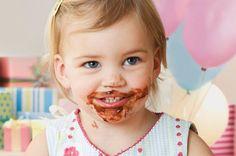 Toddler eating a cupcake