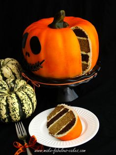 Pumpkin shaped pumpkin cake. Bake a chocolate and a pumpkin cake in bunt pans, then alternate cake halves to make striped cake!