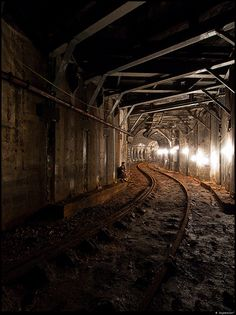 Abandoned underground train tunnel used for covert access to something.