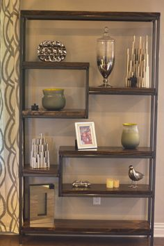 """James+James: James James custom built shelving unit with steel frame and solid wood shelving. Available in your choice of shelf stain with either brushed or industrial steel frameAppriximately 81"""" HeightApproximately 4' WidthApproximately 11"""" Depth"""