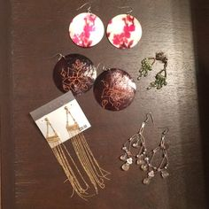 5 pairs of Earrings Round shell w pink poppy design. Round wood w flower design. Green and gold tone sparkly drop earrings. Pink stones and beads drop earrings SOLD. Guess gold tone long strandsSOLD. $10 all or $2 each with another item/s bundled. Fashion jewelry. Jewelry Earrings