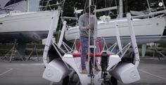 Getting ready to lower the mast into the crutch. Placing the crutch for the boom to rest on is easy.